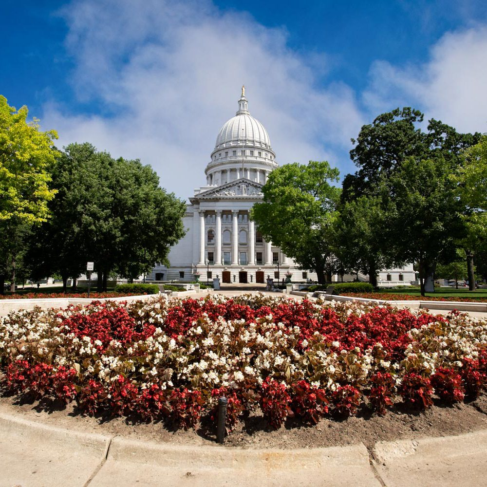 Madison, WI Capital with surrounding flowers and trees